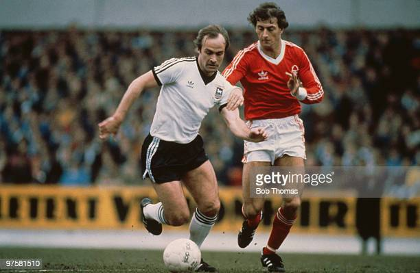 Ipswich Town captain Mick Mills is challenged by Trevor Francis of Nottingham Forest during an FA Cup 6th round match at the City Ground Nottingham...