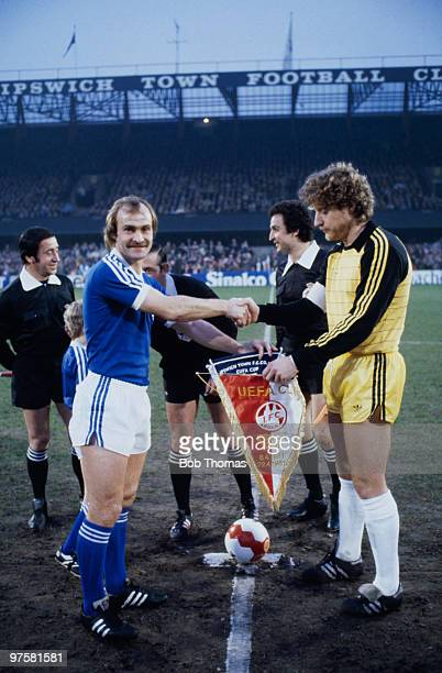 Ipswich Town captain Mick Mills shakes hands with goalkeeper Harald Schumacher of FC Cologne before the UEFA Cup semifinal 1st leg at Portman Road...