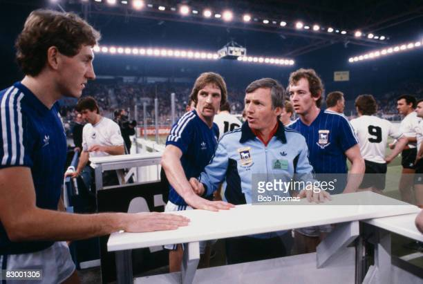 Ipswich Town coach Charlie Woods with Terry Butcher Frans Thjssen and Steve McCall during the halftime interval in their sixaside match against...