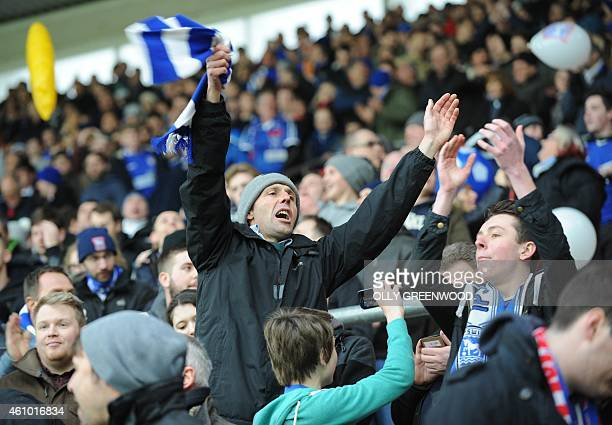 Ipswich Town fans sing in the crowd before kick off of the English FA Cup third round football match between Southampton and Ipswich Town at St...