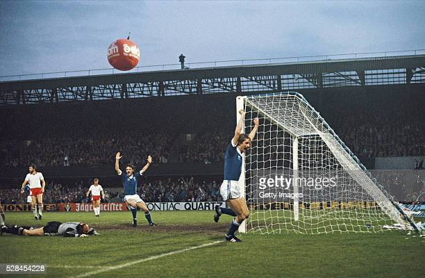 Ipswich Town goalscorer Frans Thijssen celebrates after scoring the second goal as first goalscorer John Wark joins in during the UEFA Cup Final...