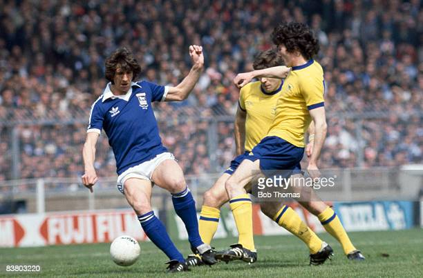 Ipswich Town striker Paul Mariner is challenged by Arsenal's Frank Stapleton and Malcolm MacDonald during the FA Cup Final at Wembley Stadium 6th May...