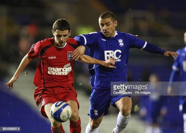 Ipswich Town's Alex Bruce and Birmingham City 's Kevin Phillips battle for the ball
