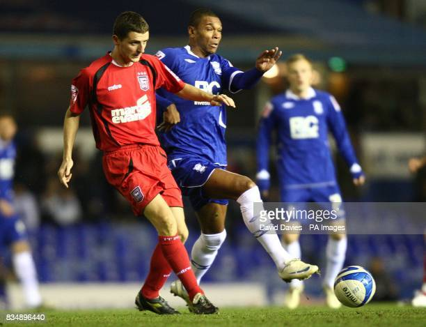 Ipswich Town's Alex Bruce and Birmingham City's Marcus Bent battle for the ball