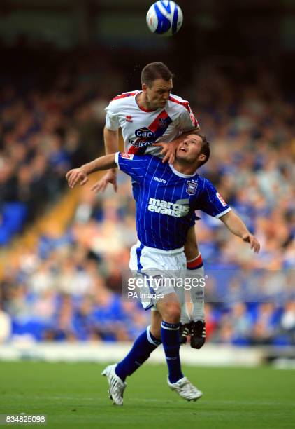 Ipswich Town's David Norris and Crystal Palace's Clint Hill battle for the ball during the CocaCola Football Championship match at Portman Road...