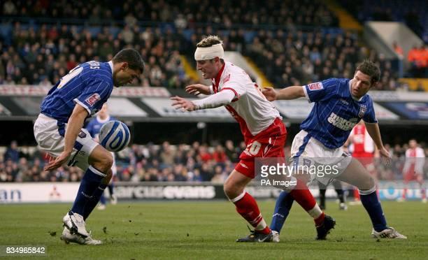 Ipswich Town's David Norris and Jonathan Walters put Birmingham City's Franck Queudrue under pressure