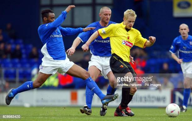 Ipswich Town's Fabian Wilnis and Matt Elliott tackle Watford's Heidar Helguson during their Nationwide Division One match at Portman Road THIS...