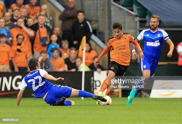 Ipswich Town's Jonathan Douglas slides in on Wolverhampton Wanderers' James Henry