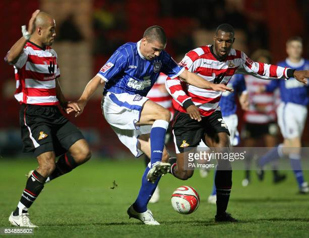 Ipswich Town's Jonathan Walters and Doncaster Rovers Shelton Martis battle for the ball during the CocaCola Football Championship match at Keepmoat...