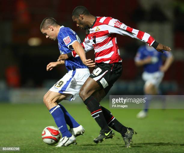Ipswich Town's Jonathan Walters and Doncaster Rovers Shelton Martis during the CocaCola Football Championship match at Keepmoat Stadium Doncaster