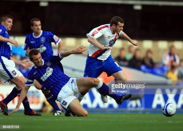 Ipswich Town's Jonathan Walters tackles Crystal Palace's Shaun Derry during the CocaCola Football Championship match at Portman Road Ipswich