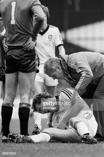 Ipswich Town's Kevin Beattie screams in agony as he receives attention for a broken arm