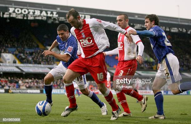 Ipswich Town's Moritz Voltz and Jonathan Walters put Birmingham City's James McFadden under pressure