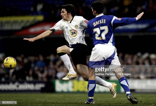 Ipswich's Jonathan Macken clashes with Leeds' Jonathan Douglas during the CocaCola Championship match at Portman Road Ipswich