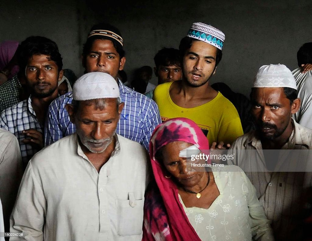 Iqbal and his family along with other Muslims who have been separated from Hindu community by team of police at Islam Nagar in Shahpur area during communal violence on September 10, 2013 in Muzaffarnagar, India. No untoward incident was reported from Muzaffarnagar today as 975 people were arrested for their direct or indirect role in the communal violence that has left 35 dead.