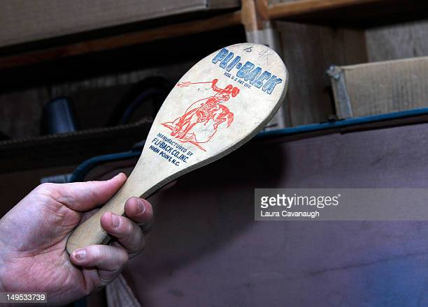 Ira Kramer shows Bettie Page's paddle at Movie Star News Collection auction press preview at Movie Star News on July 25 2012 in New York City