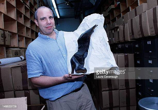 Ira Kramer shows Bettie Page's shoes at Movie Star News Collection auction press preview at Movie Star News on July 25 2012 in New York City