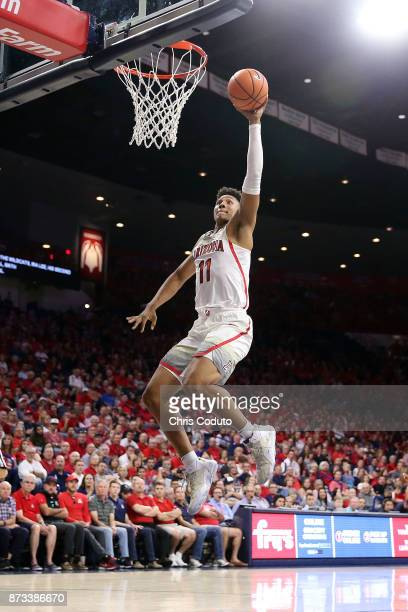 Ira Lee of the Arizona Wildcats attempts a dunk during the second half of the college basketball game against the UMBC Retrievers at McKale Center on...