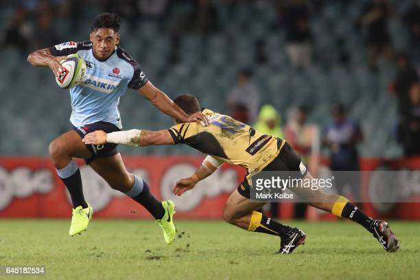 Irae Simone of the Waratahs fends off Jono Lance of the Force during the round one Super Rugby match between the Waratahs and the Force at Allianz...
