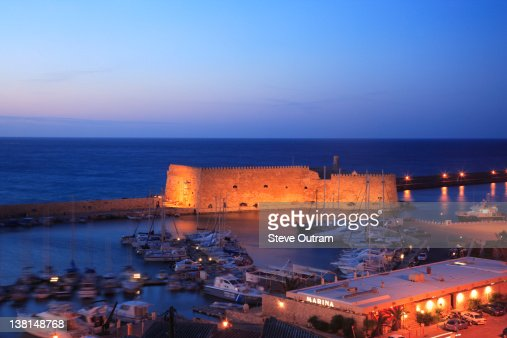 Iraklion harbour and Venetian Fortress at night,