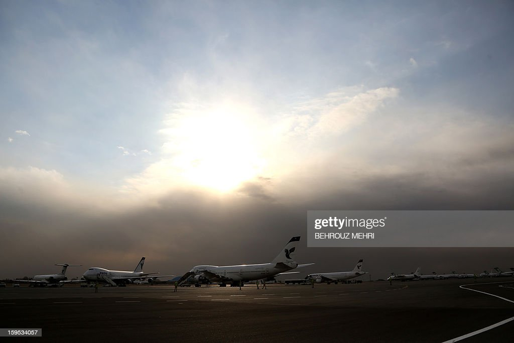 Iran Air passenger planes sit on the tarmac of the domestic Mehrabad airport in the Iranian capital Tehran on January 15, 2013. Austrian Airlines said the previous day that it has stopped its flights to Tehran because they were not profitable any more in a decision that comes after the subsidiary of German carrier Lufthansa had already in November cut the number of weekly flights from Vienna to the Iranian capital to three.