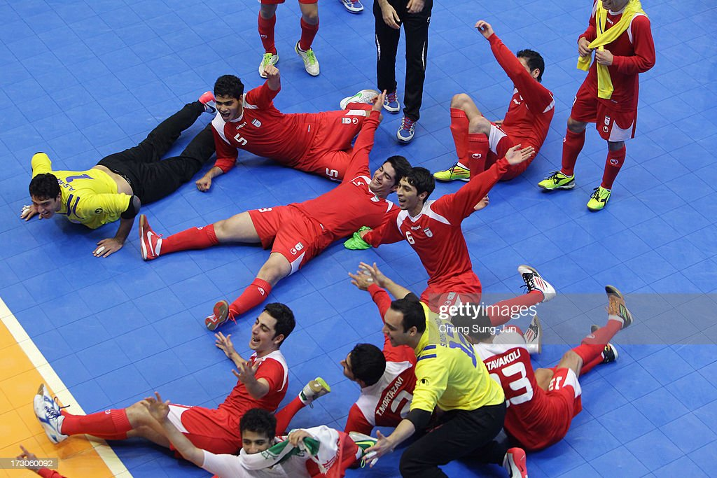 Iran players celebrate after winning against Japan during the Men's Futsal Gold Medal match at Songdo Global University Campus Gymnasium during day eight of the 4th Asian Indoor & Martial Arts Games on July 6, 2013 in Incheon, South Korea.
