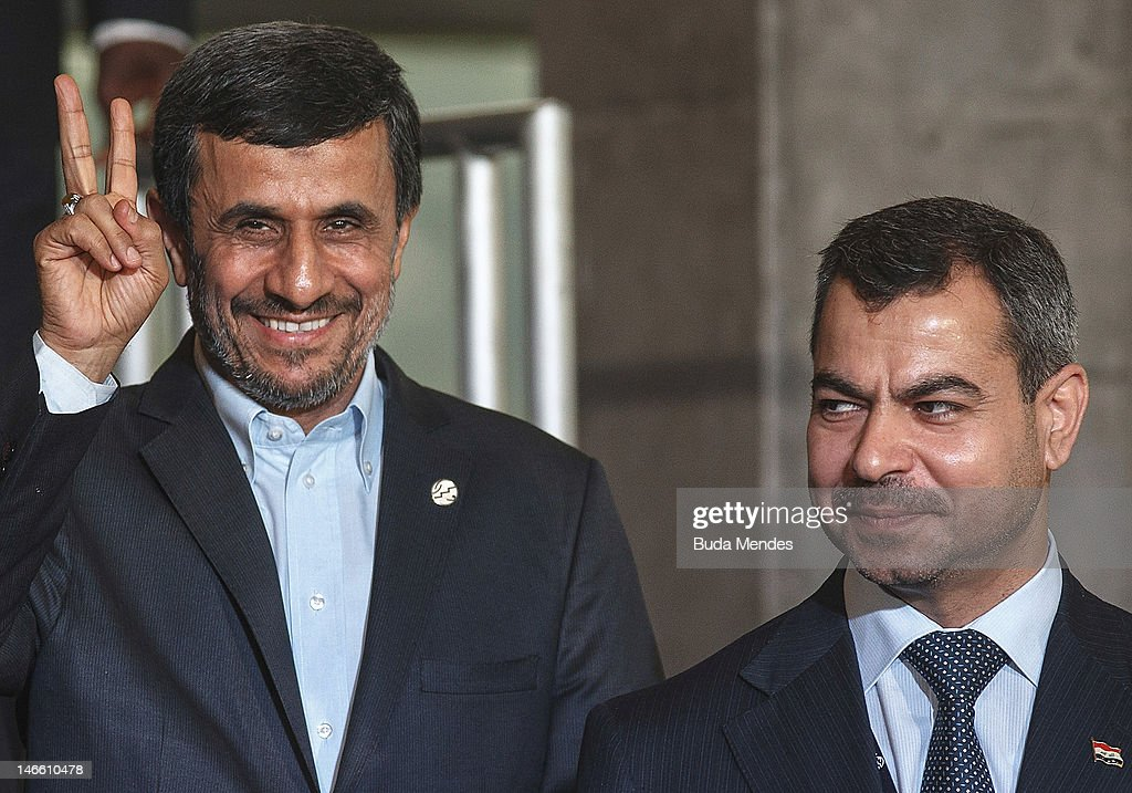 Iran President Mahmoud Ahmadinejad waves next to Ali alShukri Minister of Planning of Iraq and Arab League Chair before the group photo at the United...