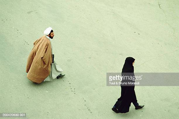 Iran, Qom, man and woman walking, elevated view