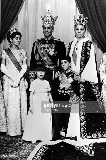 21st October 1967 The Shah of Persia and the Empress Farah in bejewelled splendour in the Throne room of the Golestan Palace in Teheran after the...