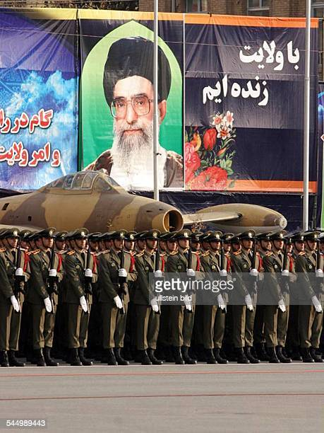 Officers and soldiers of the iranian army during a parade In the background a picture of Ayatollah Ali Khamenei
