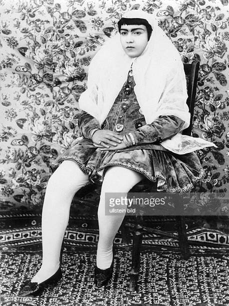 Iran upper class woman dressed for a visit she has put off the chador probably in the 1910s