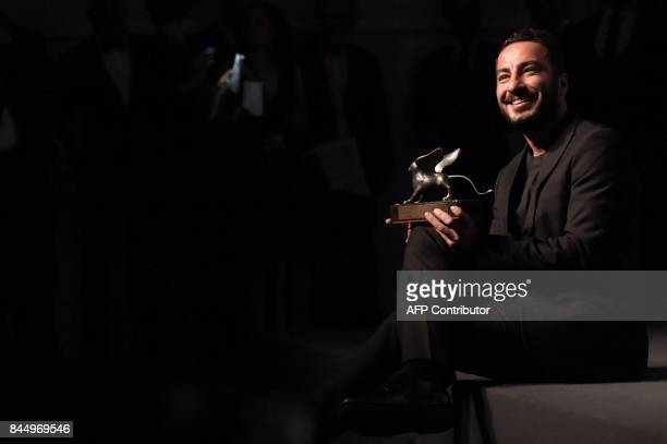 Iranian actor Navid Mohammadzadeh poses during a photocall after he receives the Orizzonti Award for Best Actor for his character in the movie 'No...