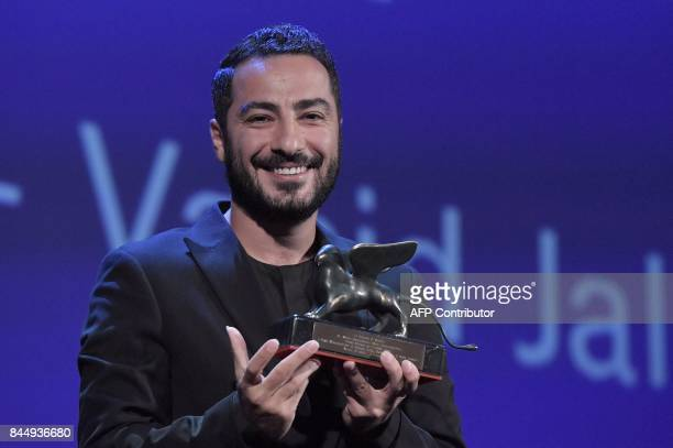 Iranian actor Navid Mohammadzadeh receives the Orizzonti Award for Best Actor for his character in the movie 'No Date No Signature' during the award...