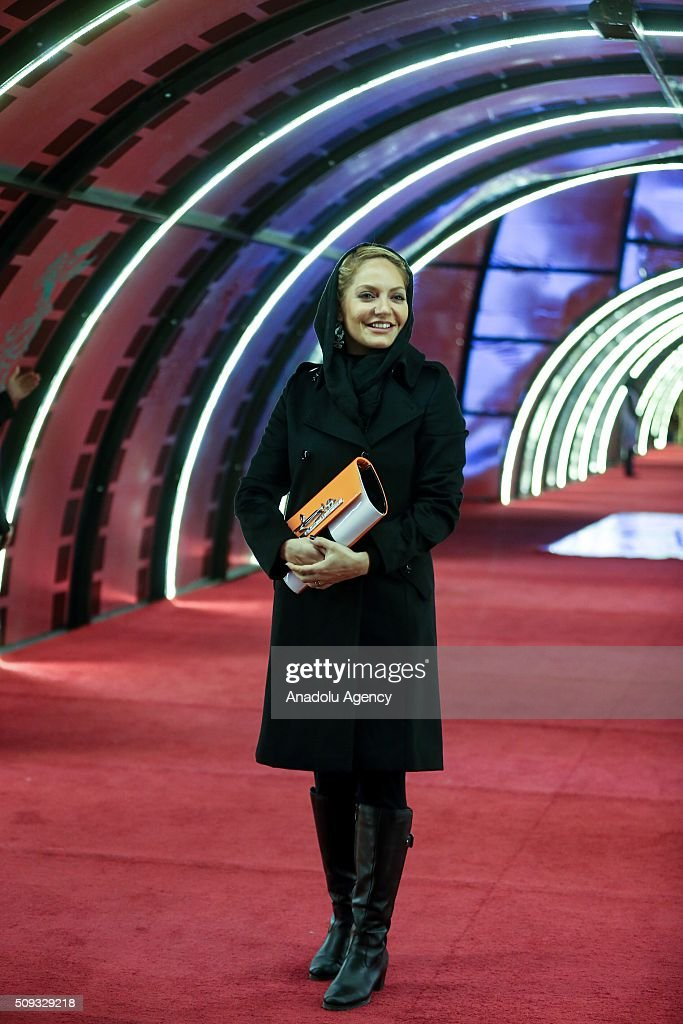 Iranian actress Mahnaz Afshar poses as she arrive for a screening during the 34th edition of the Fajr International Film Festival at Milad Tower in Tehran, Iran on February 10, 2016.