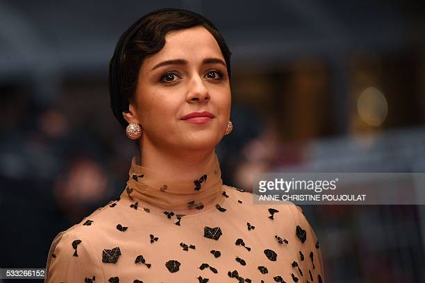 Iranian actress Taraneh Alidoosti poses as she arrives on May 21 2016 for the screening of the film 'The Salesman ' at the 69th Cannes Film Festival...