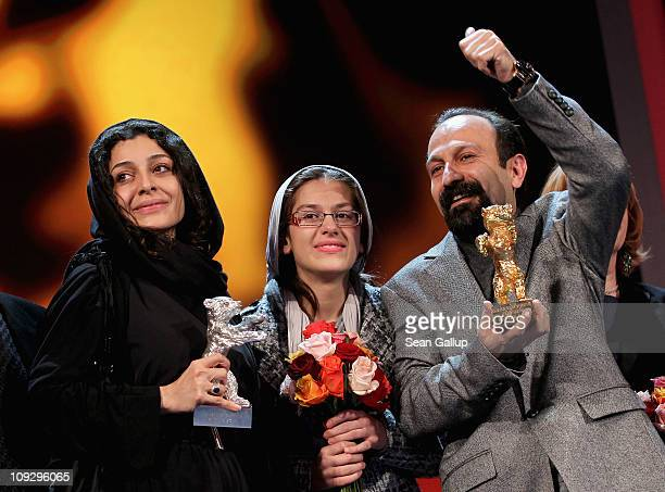 Iranian actresses Sareh Bayat Sarina Farhadi and director Asghar Farhadi celebrate winning the Golden Bear for best movie at the Award Ceremony...