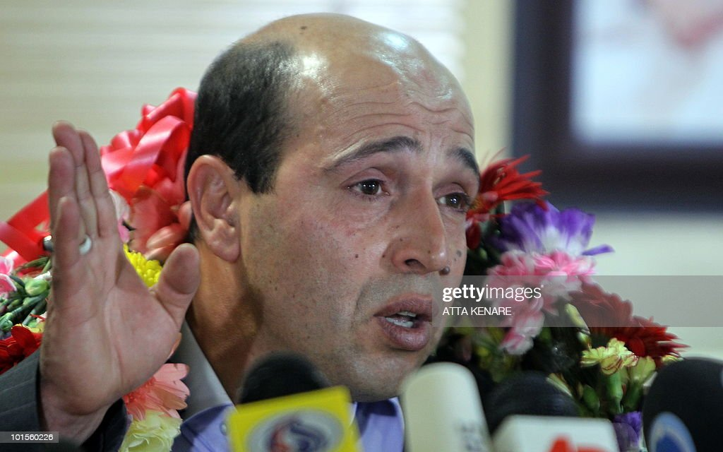 Iranian agent Ali Vakili Rad gestures as he answers media questions upon his arrival at Imam Khomeini Airport in Tehran, on May 18, 2010 after his release from a French prison where he was jailed for murdering the Shah's last prime minister Shapour Bakhtiar. France decided yesterday to send home Rad who was serving a life sentence for stabbing Bakhtiar to death at his home outside Paris in August 1991, but he had recently asked for parole and Iranian leaders had linked his case to that of Clotilde Reiss, a young French academic accused of spying.
