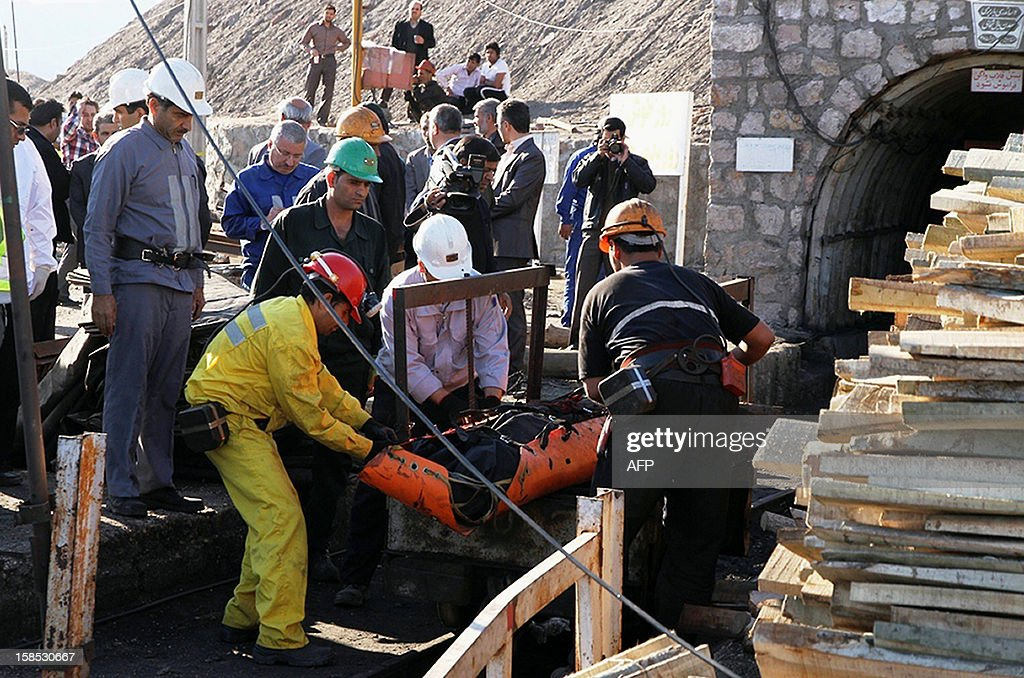 Iranian aid workers wheel the body of one of the miners at Parvadeh Tabas coal mine near the central city of Tabas, some 555 kilometres (345 miles) southeast of Tehran, on December 18, 2012 after its collapse which left four miners dead and another four missing. Tabas governor Ahmad Talebian Moqadam said that the probable cause was an 'explosion of accumulated dangerous gas' in the mine.