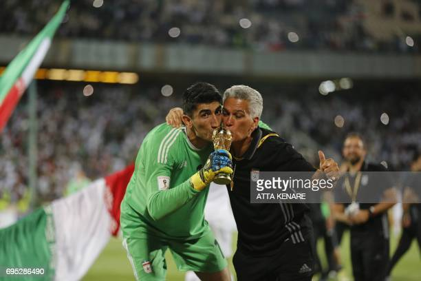 Iranian Alireza Bairanvand and Dan Gaspar celebrate after winning the 2018 World Cup qualifying football match between Iran and Uzbekistan at the...