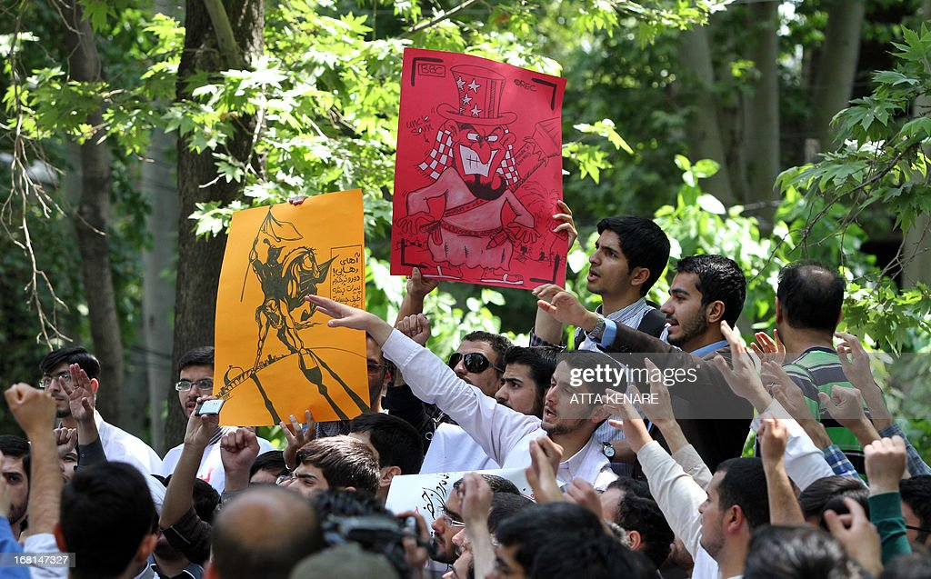 Iranian and Syrian students attend an anti-Israeli demonstration in front of the United Nations offices in Tehran, on May 6,2013, to condemn Israeli air strikes on targets near the Syrian capital Damascus. Israeli raids on Syrian targets at the weekend killed at least 15 soldiers, a watchdog said, as UN chief Ban Ki-moon led calls for restraint to prevent the war spilling over borders.