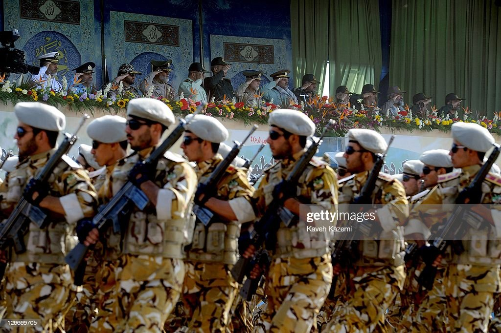 Iranian armed forces march in front of Major General Hassan Firoozabadi (C) and other saluting military commanders during a parade commemorating the 31st anniversary of Iran-Iraq war on September 22, 2011 in Tehran, Iran. Iran is holding military parades in Tehran and other parts of the country on the first day of the Sacred Defence Week. Tehran's parade began to the north of Imam Khomeini's mausoleum providing the army, Islamic Revolution Guards Corps, Law Enforcement Force and Basij with an opportunity to display their state of military preparedness, in which armaments and indigenously built military equipment including Shahab missiles, unmanned aircrafts, Zulfaqar tanks, and a variety of rapid fire machine guns were showcased.