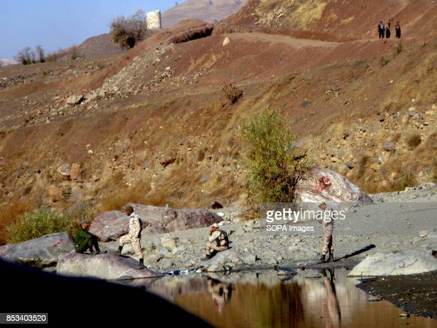 Iranian border agent are waiting alongside of river to not let Kulbuers cross the border Children work within this challenging environment as well...