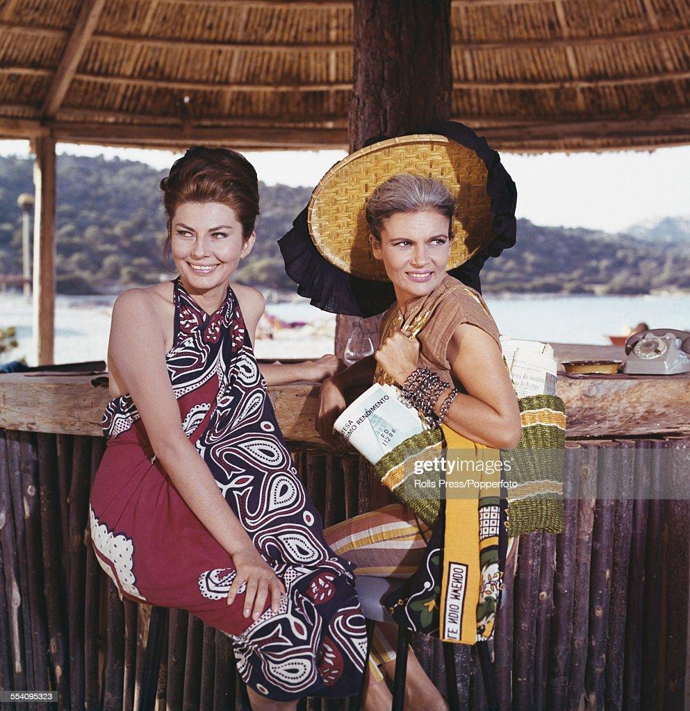 Iranian born actress and second wife of Mohammad Reza Pahlavi Shah of Iran Soraya EsfandiaryBakhtiari pictured left with a friend at a beach side bar...