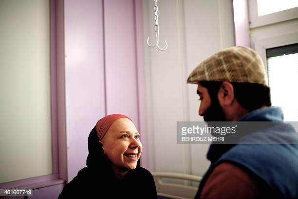 Iranian breast cancer patient Farvah shares a moment with her fiance Saleh before her mastectomy operation to remove a breast at a clinic in Tehran...