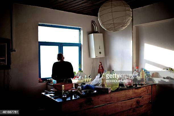 Iranian breast cancer patient Farvah works in the kitchen of their countryside house in a village near the Caspian Sea port city of Bandar Anzali...