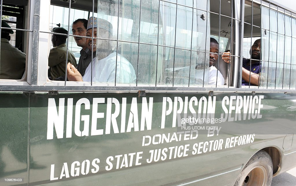 Iranian businessman and alleged Iranian Revolutionary Guard member Azim Aghajani (L) and Nigerian suspect Ali Abbas Jega (2nd L) sit on March 7, 2011 in a bus taking him to prison after a hearing at the Federal High Court in Lagos. Nigerian prosecutors on March 7 amended the charges against Aghajani and Jega on trial over a shipment of rockets, explosives and grenades seized in the West African nation. The new charges are similar to the old accusations, but provide more specifics on the types of weapons involved in the October 2010 seizure, naming bombs, grenades and rockets. They accuse the two suspects of illegally importing them and say the weapons were under their control. They are also accused of having falsely declared the 13 containers seized at a Lagos port as building materials. Both men pleaded not guilty to the new charges.
