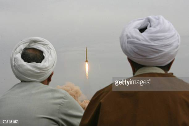 Iranian clergymen watch a Shahab3 longrange ballistic missile fird by Iran's Revolutionary Guards in the desert outside the holy city of Qom 02...