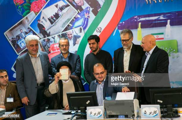 Iranian cleric and head of the Imam Reza charitable foundation Ebrahim Raisi poses for media at the Interior Ministry building on April 14 2017 in...