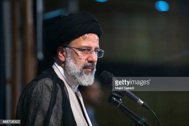 Iranian cleric and head of the Imam Reza charitable foundation Ebrahim Raisi delivers a speech after registering his candidacy for the upcoming...