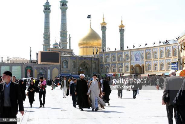 Iranian clerics walk outside the Massoumeh holy shrine in the city of Qom some 130 kilometres south of Tehran on February 24 2016 Women make up 504...